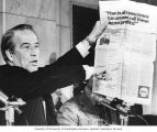 "Senator Henry M. Jackson holding up a Shell Company newspaper advertisement entitled, ""How in..."