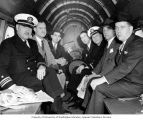 Congressman Henry M. Jackson (far right) with others probably en route to a ship launching...