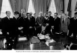 Senator Henry M. Jackson (third from left), Alaska Senators Mike Gravel and Ted Stevens (left and...