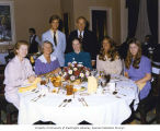 Liv Ullmann sitting at a dinner table with Mrs. Slade Gorton and Senator Henry M. Jackson and his...