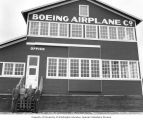 Senator Henry M. Jackson standing with three men in front of the Red Barn, Boeing Company's...