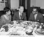 Senator Henry M. Jackson dining with unidentified people at an event, probably in Washington,...