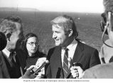 Senator Henry M. Jackson and Seattle Mayor Wes Ulman  talking with reporters during a visit to...