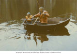 Henry M. Jackson and his son, Peter, catching a fish on a boat in an unidentified lake, June 1970