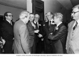 Senator Henry M. Jackson talking with Vice President Walter Mondale and others during the...