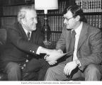 Senator Henry M. Jackson discussing a document with Bill Van Ness, Chief Counsel to the Energy and...