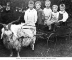 Henry M. Jackson with childhood friends playing with a cart pulled by goat, Everett, Washington,...