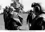 Senator Henry M. Jackson and members of the U.S. Navy during a tour of the aircraft carrier USS...