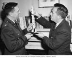 "Lieutenant Colonel Edward N. Hathaway presenting a model of the Army's ""Redstone""..."