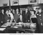 Senator Henry M. Jackson sitting at his desk with Veterans of Foreign Wars' (VFW) members, Senate...