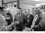 Senator Henry M. Jackson talking with Jim Garner and others during a visit to the Cispus...
