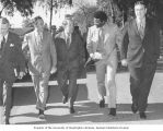 Senator Henry M. Jackson walking with administrators and the student government president before...