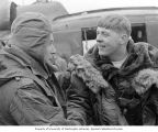 Senator Henry M. Jackson talking with Army Warrant Officer Allen V. Olsen before taking an aerial...