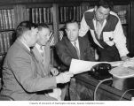 Senator Henry M. Jackson sitting at his desk with Native Americans from Everett, Washington,...