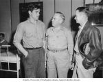 C. W. Bishop talking with two men in U.S. Navy hospital during U.S. Congressional delegation visit...