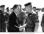 Senator Henry M. Jackson shaking hands with Specialist Fifth Class Cole during a tour of the U.S....
