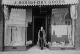Anna Borish Lustig standing in front of Borish Dry Goods store, 1702 Yesler Way, Seattle,...