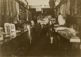 Abraham Steinberg with cousin Louise Aronin inside Steinberg's clothing store on S.  Jackson St.,...