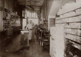 Owner Joseph Sturman (left) and his son William (Billy) in their store, Everett Shoe Hospital,...
