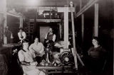 Owner Charles Stusser (center) with workers inside Charles Stusser Canvas Mfg. Co., 1311 1st Ave.,...