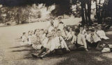 Settlement House children eating treats during outing, Seattle, Washington, ca. 1910-1920