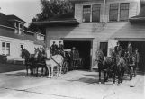 Firemen on horse-drawn trucks at Station No. 24, 5th Ave. W. and W. Galer St., Seattle,...