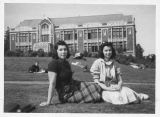 Elsie and friend on the University of Washington campus showing Savery Hall in background, ca....