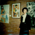 Elsie Deutsch Weiner with paintings at Jewish Community Center Art Show, 1975