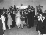 Harry and Elsie Weiner walking down the aisle during wedding ceremony, Seattle, January 19, 1943