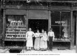 Samuel and Herman Mosler with unidentified store employees in front of Mosler Bakery, Yesler Way,...