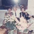 Jacob sitting on a couch in between his second wife Meta Buttnick and his sister Celia Kaplan...
