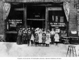Group gathered in front of Red Front Furniture Co. after a parade, 308-310 2nd Ave. S., Seattle,...