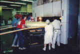 Brenner Brothers bakers easing world's largest bagel into oven, Bellevue, July 1994