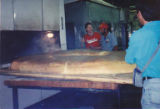 Brenner Brothers world's largest bagel coming out of oven, Bellevue, July 1994