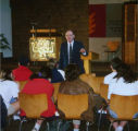 Rabbi Norman Hirsh and students in sanctuary, Temple Beth Am religious school, ca. 1980s-1990s