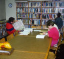 Children and adults in synagogue library, Temple Beth Am religious school, ca. 1980s-1990s