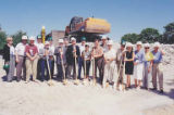 Group with shovels and hard hats at the groundbreaking for The Summit, a retirement community, at...