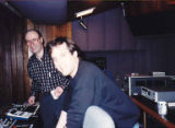 Kurt Steinbrecher, Ph.D., and Steve Lawson (owner of studio) checking sound at control board at...