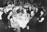 Group sitting at table at Rabbi Samuel Penner's installation banquet for Herzl Congregation at...