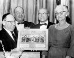 Jewish National Fund honor being presented to Abe and Anna Silver, December 1964