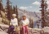 Edith Loewenstein Braun and another woman sitting on wall at Crater Lake, Oregon,  1977