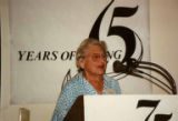 "Adelaide Freiberg at podium of ""75 Years of Caring,"" the 75th anniversary celebration of..."