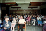 "Audience at ""75 Years of Caring"" celebration for 75th anniversary of Carolyn..."