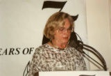"Arva Gray at podium of ""75 Years of Caring,"" the 75th anniversary celebration of Carolyn..."