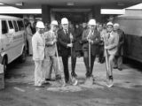 Group posing with shovels at the groundbreaking ceremony for the Esfeld addition to the Carolyn...