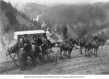 Aubrey Levy and travelling companions with horses and carriage on a mountain road, possibly in...