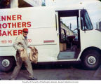 Charlie Brenner holding bags in front of Brenner Brothers Bakery delivery truck, Bellevue, ca....