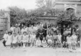 Group portrait of children and adults outside the Tientsin Jewish School, June 1931