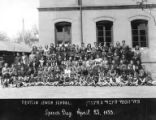 Group portrait of children and adults outside the Tientsin Jewish School on Speech Day, April 23,...