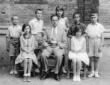 Group portrait of children outside Tientsin Jewish School with Reuven Greenfield seated in the...